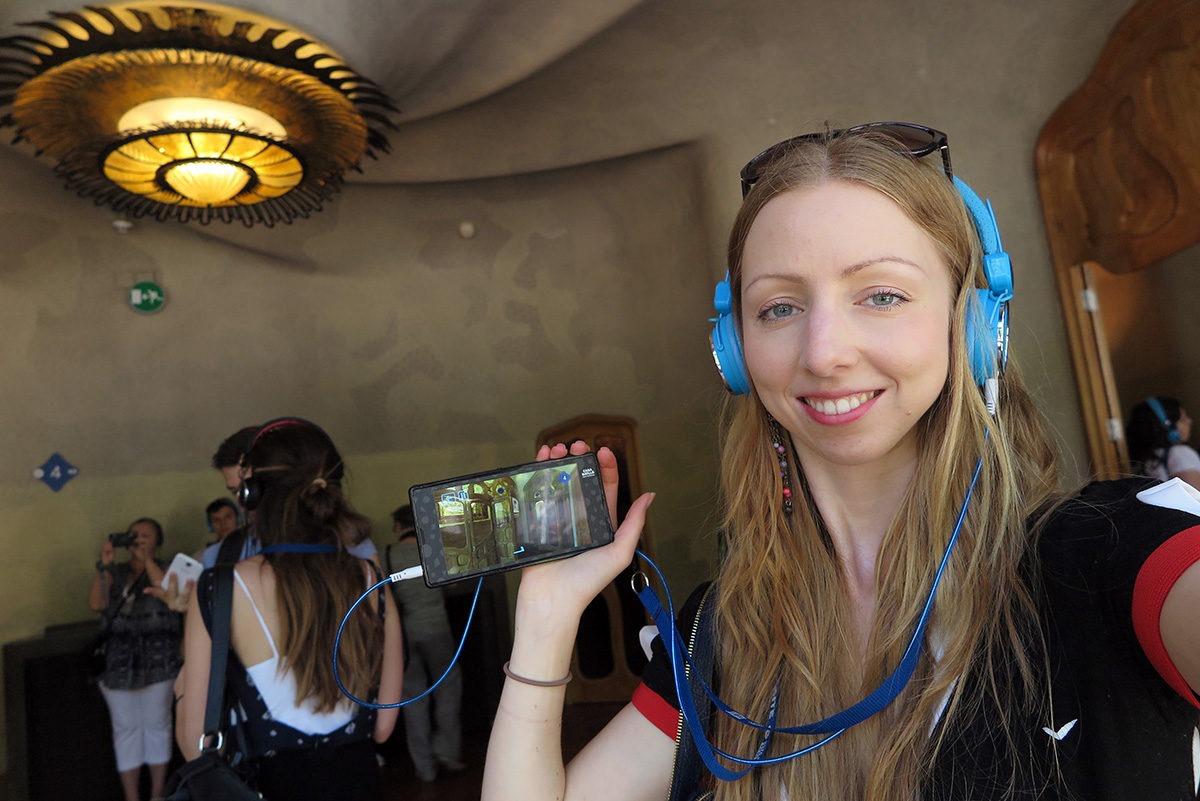 Using a video guide in Casa Batllo, Barcelona