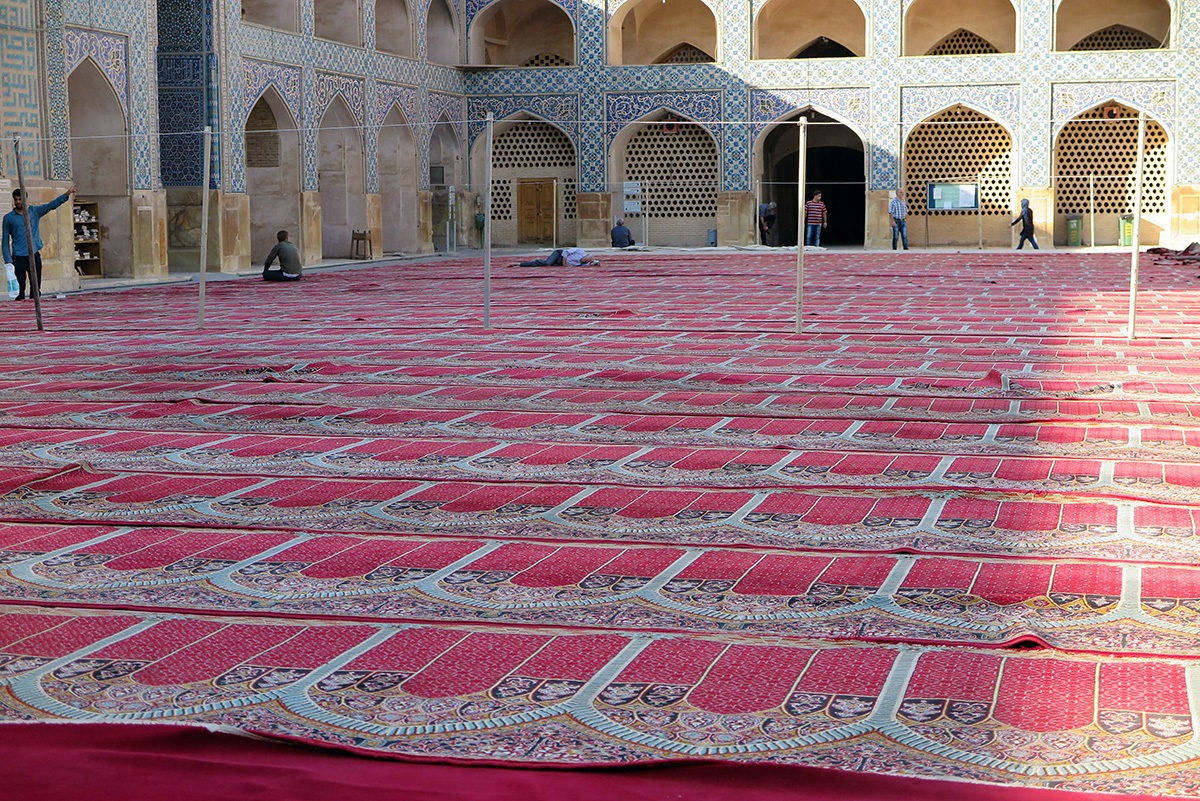 Getting ready for a prayer in a mosque in Esfahan, Iran