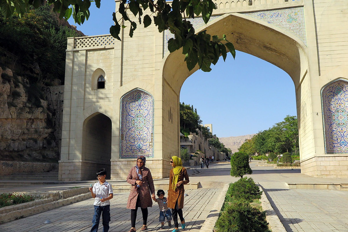 Women with kids in front of Quran Gate, Shiraz, Iran