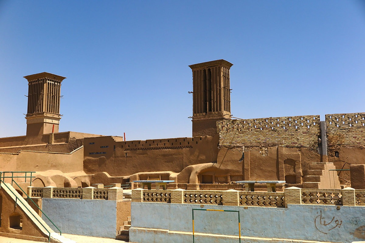 Charming Yazd - that's badgir chimneys and mud structures.