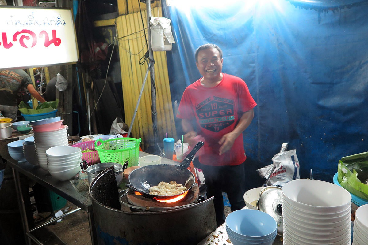 This guy is a hero, making around 300 noodle dishes a day - all on fire in a dirty little backstreet. - street food in Bangkok