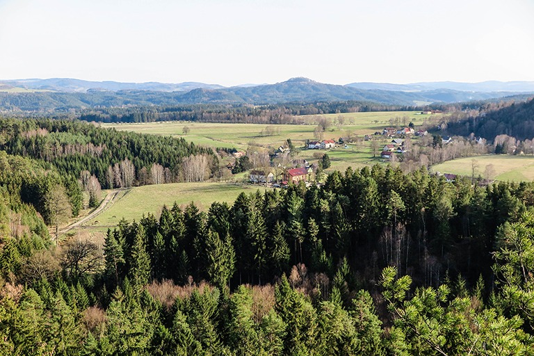 Beautiful views from Šaunštejn: a village of Vysoká Lípa, with forests and fields all around.