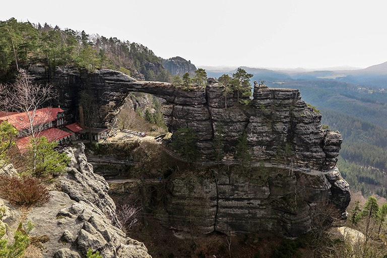 Pravčická Gate with the red roof of Falcon's Nest, Bohemian Switzerland