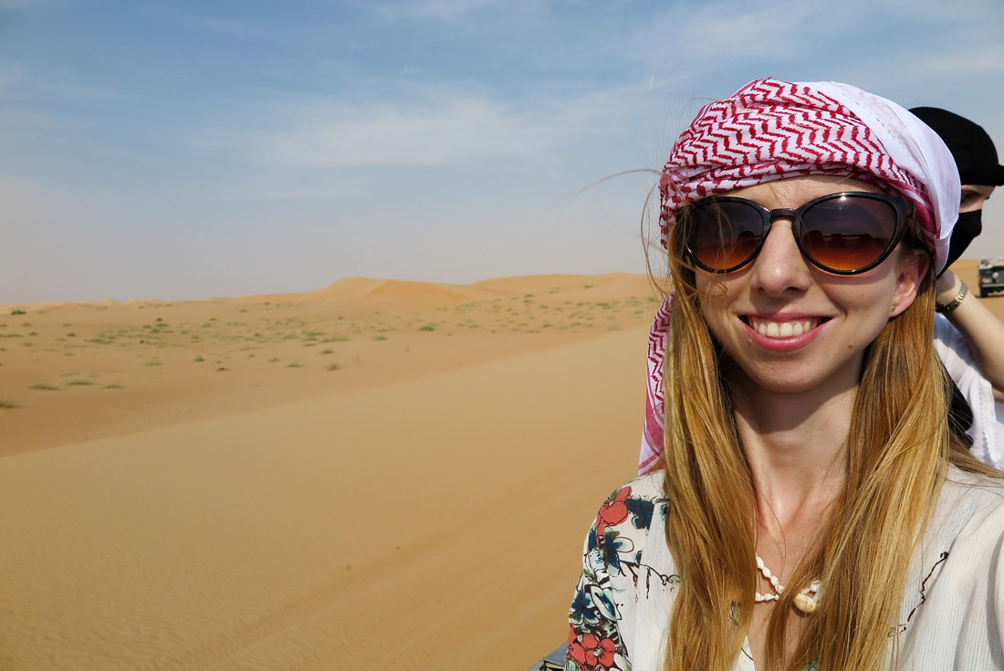 Veronika wearing a shemagh in the Dubai desert