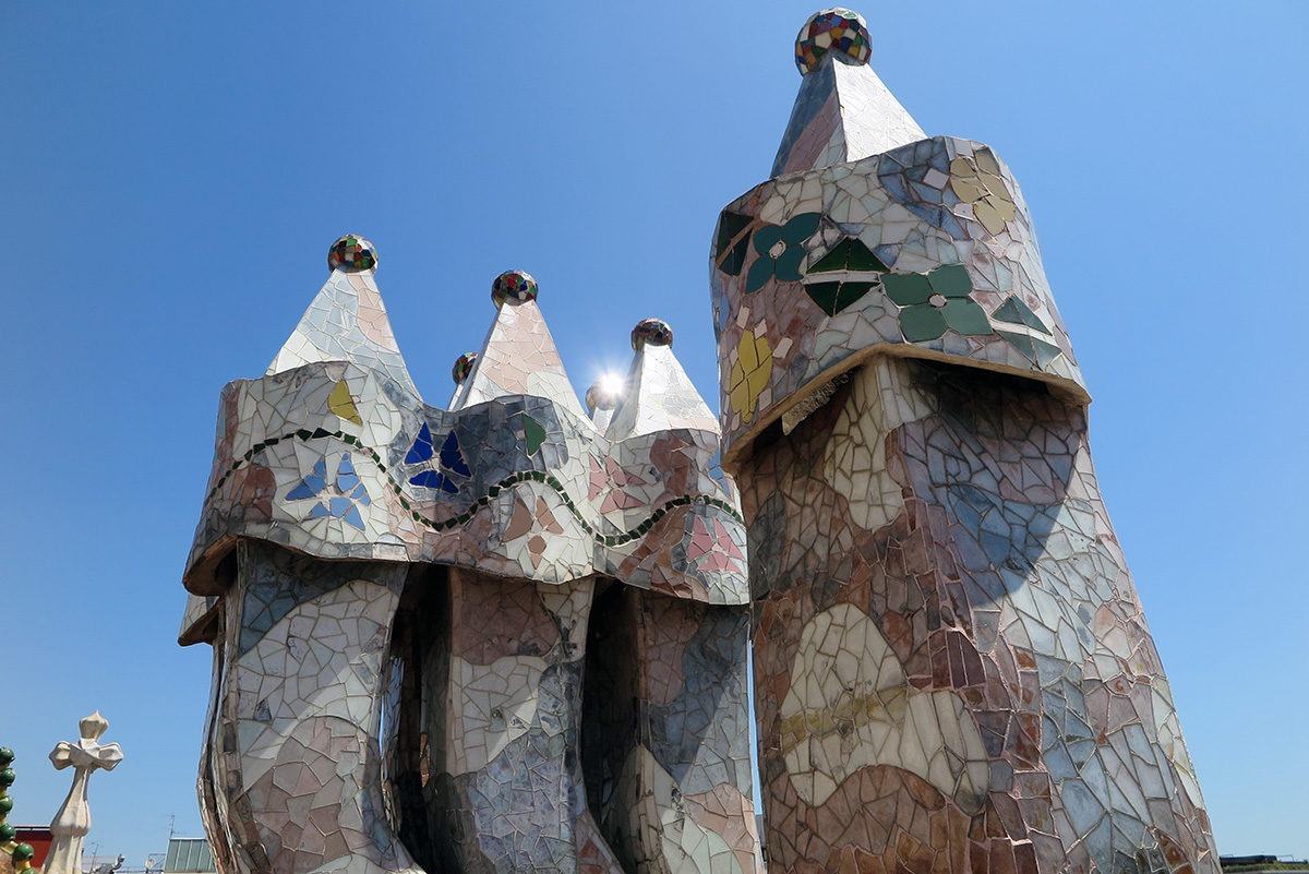 Chimneys of Casa Batllo covered with trencadís, broken tiles.