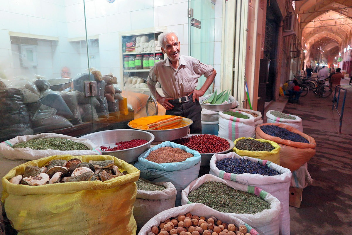 Spice shop owner, bazaar in Esfahan, Iran