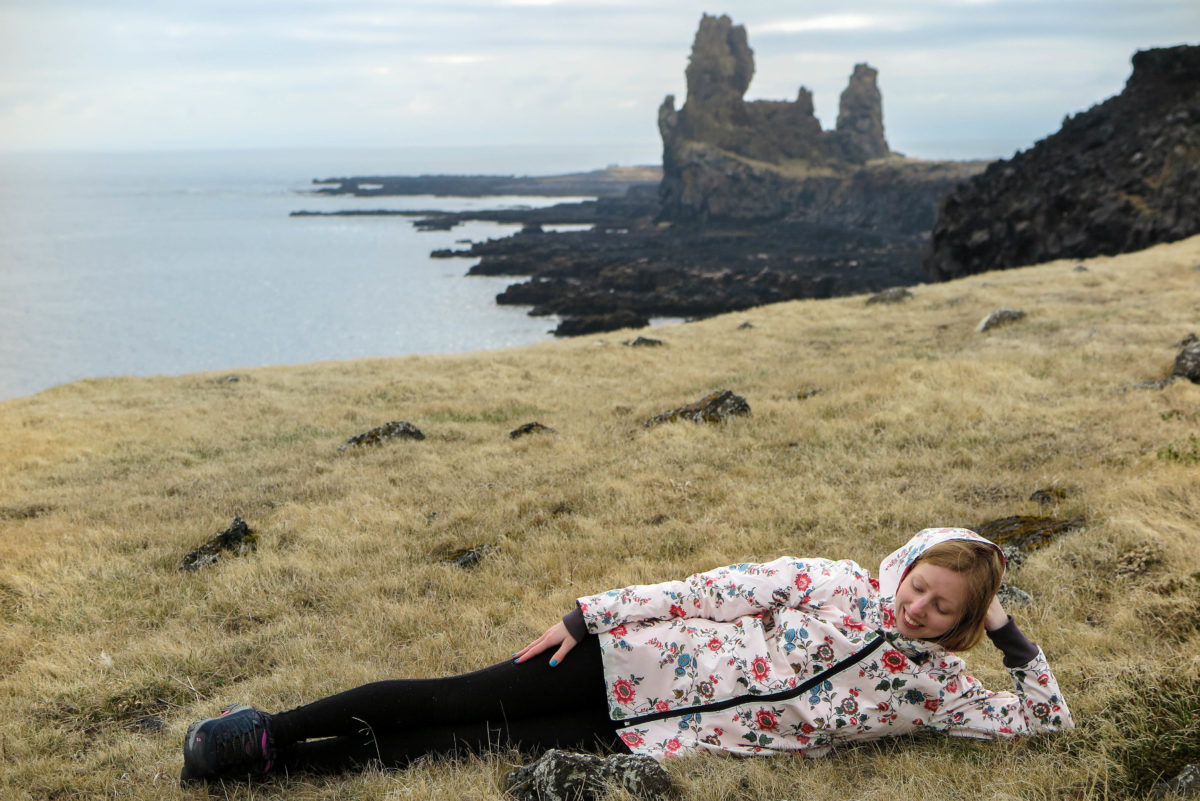 I couldn't resist lying down on the soft yellow grass.. with Lóndrangar cliffs behind
