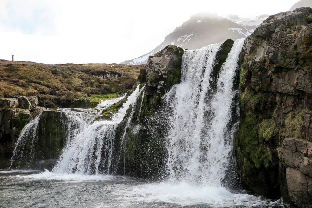 Kirkjufellsfoss waterfall, lying just next to Kirkjufell Mountain.
