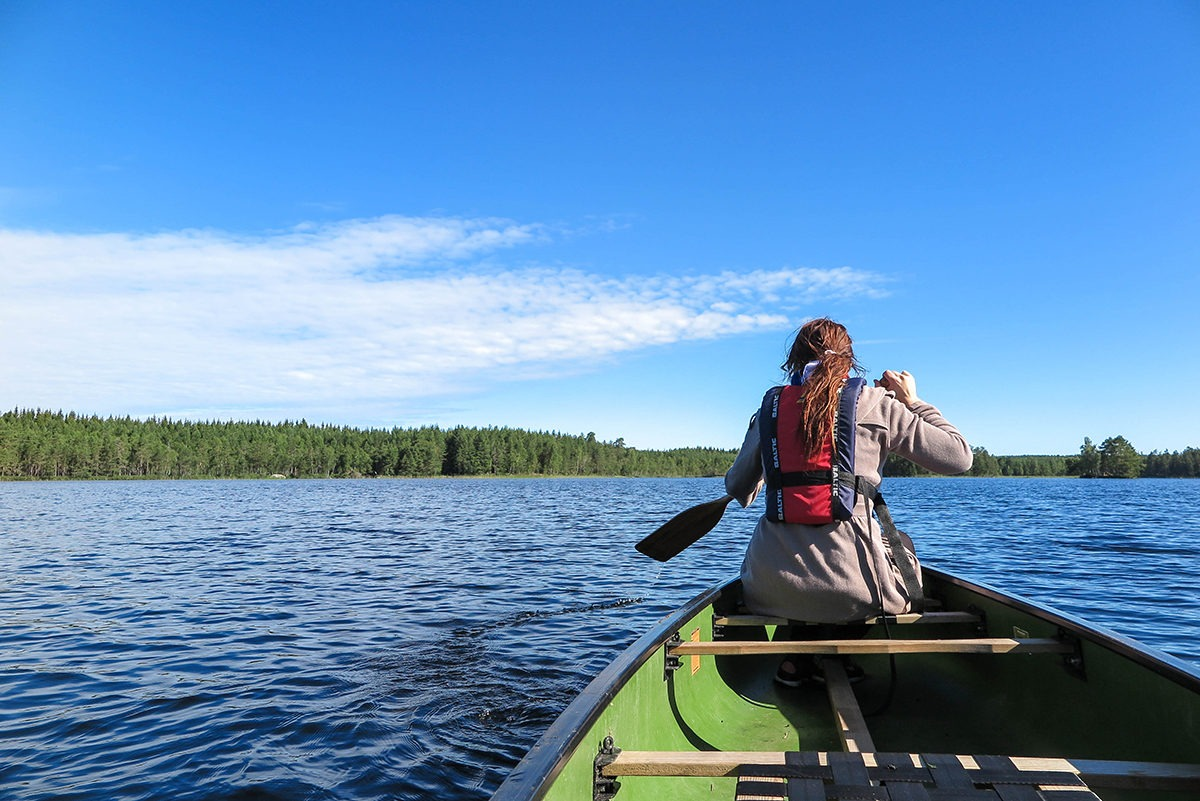 Paddling on the calm lake by Kolarbyn Huts www.travelgeekery.com