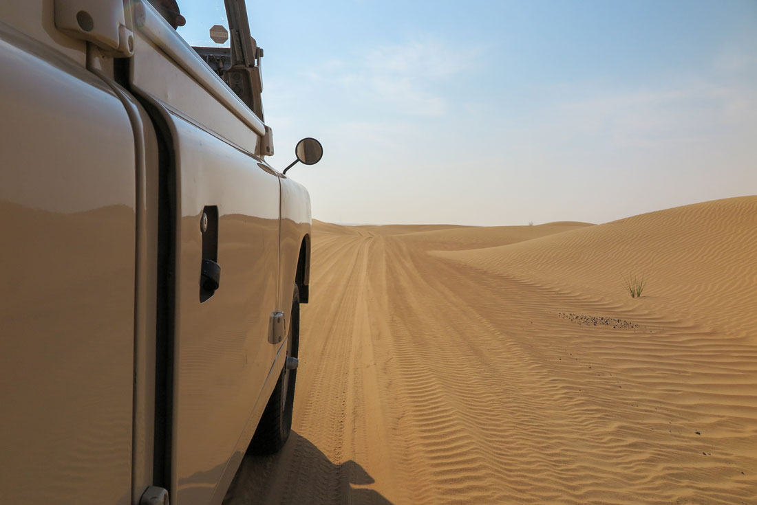Riding a Land Rover in the desert of Dubai.