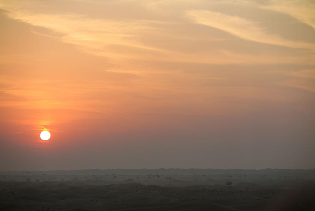 Sun rising above Dubai desert