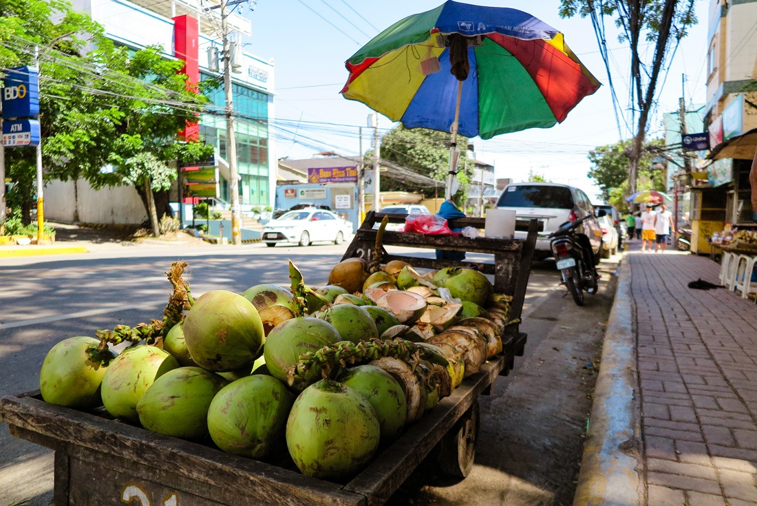 Young coconuts sold on the street in Cebu, Philippines www.travelgeekery.com