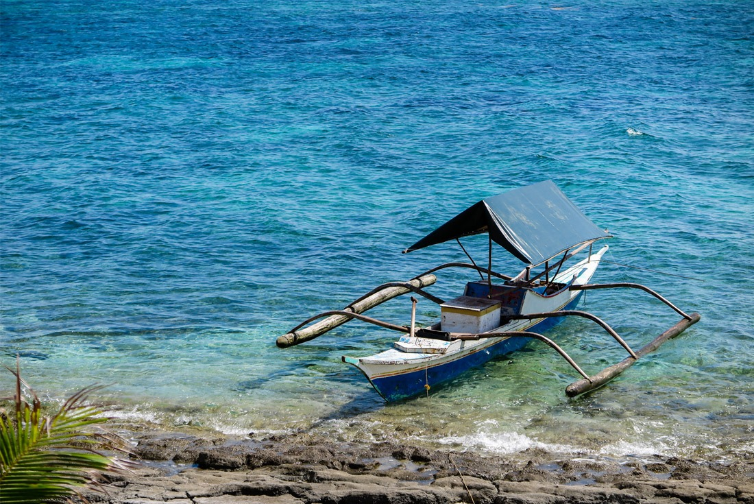 Firshermen's pump boat anchored by the shores of Kalanggaman Island