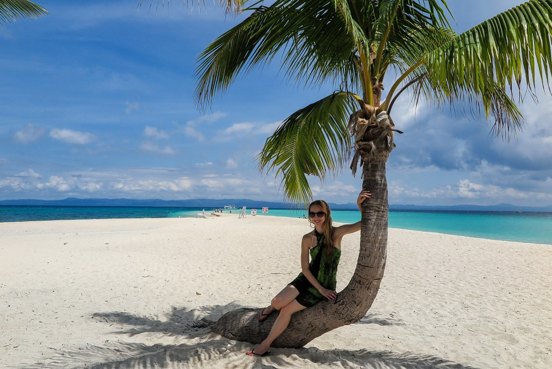 Resting in the shade of a coconut palm tree.. Kalanggaman, Philippines
