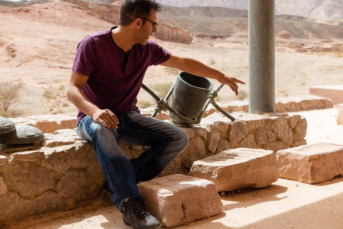 A guide in Timna National Park explaining the copper smelting process