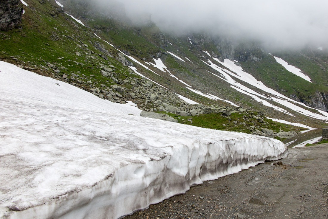 A layer of snow by the road on top of Transfagarasan.