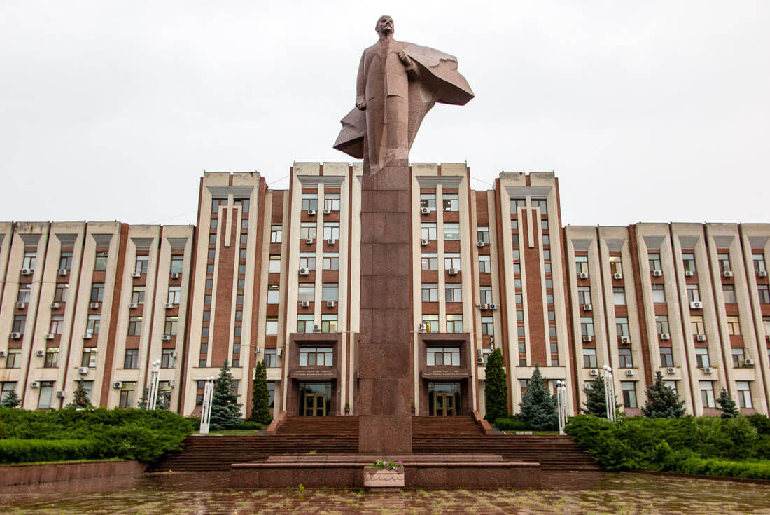 Another government building with Lenin statue in front