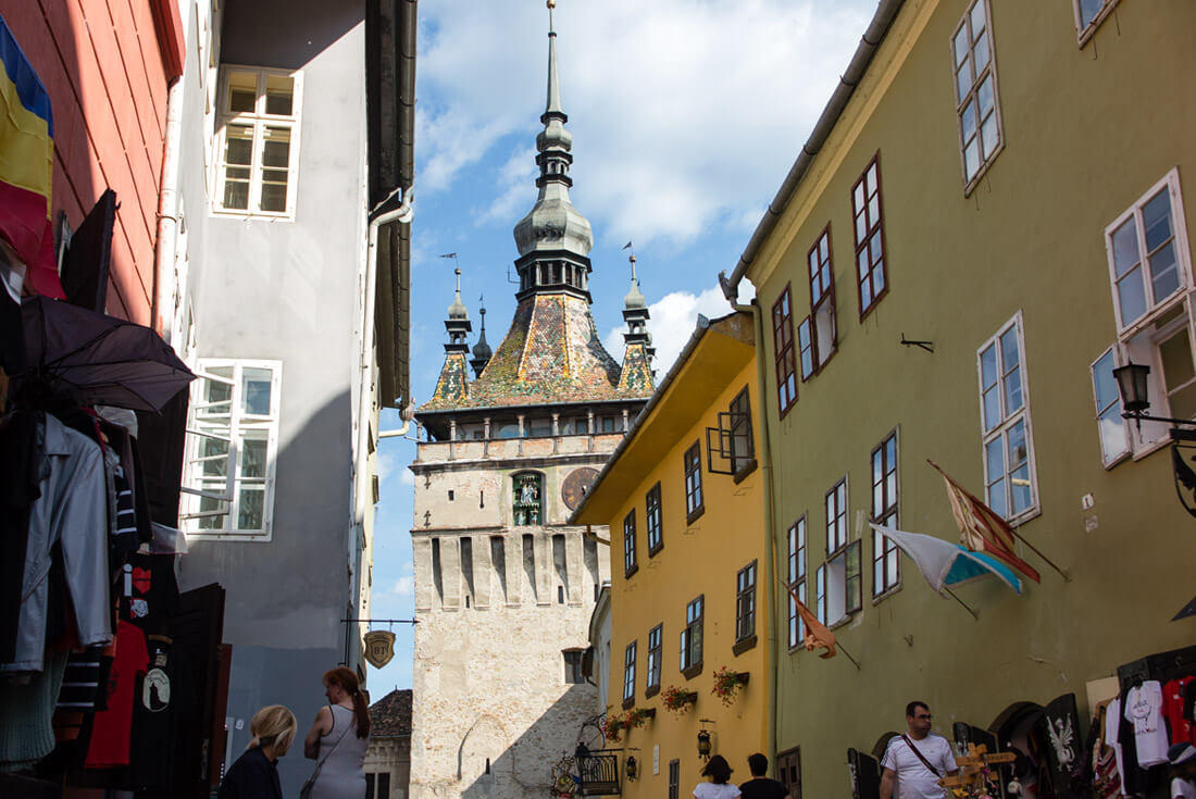 Clock Tower in Sighisoara peeking from behind the Dracula House