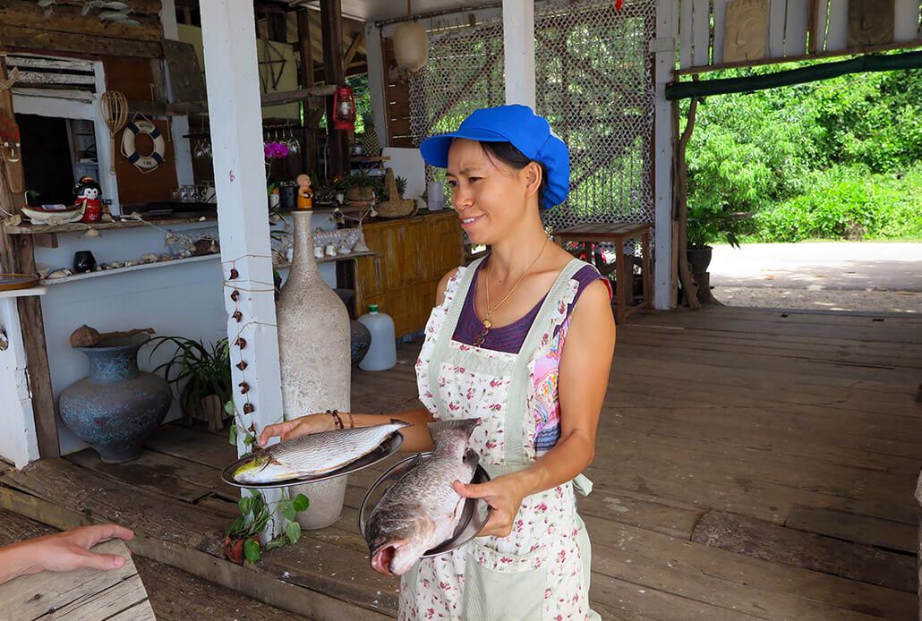 Lady at Shanti Shanti showing us what fish we could have - Koh Lanta, Thailand