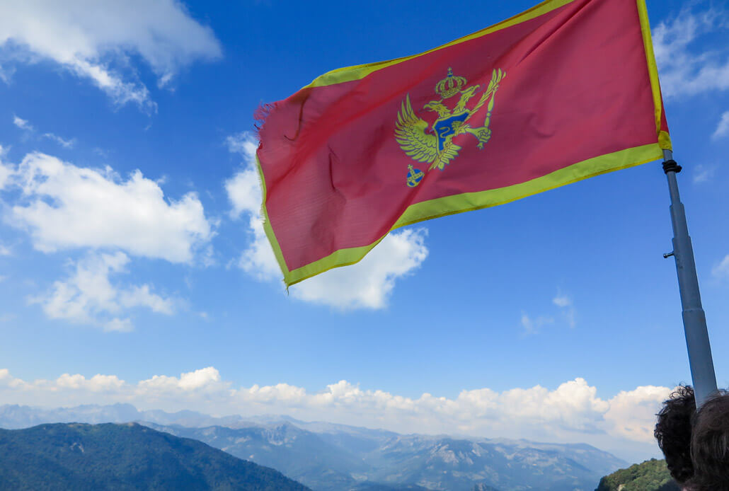 Montenegro flag on top of Bendovac viewpoint, Bjelasica Mountains, Montenegro