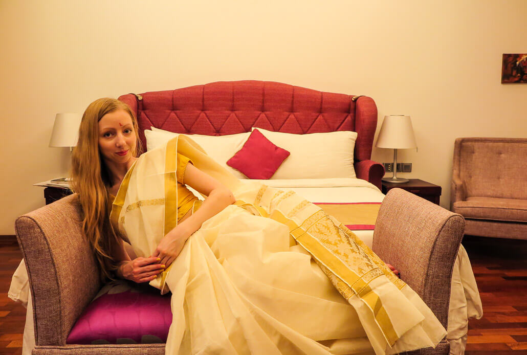 Veronika TravelGeekery in the room of Raviz hotel, Kerala, India