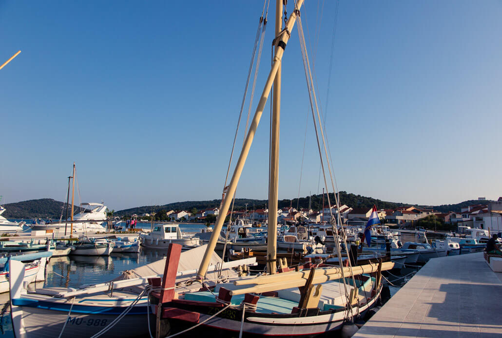 Wooden boats anchored in Betina port