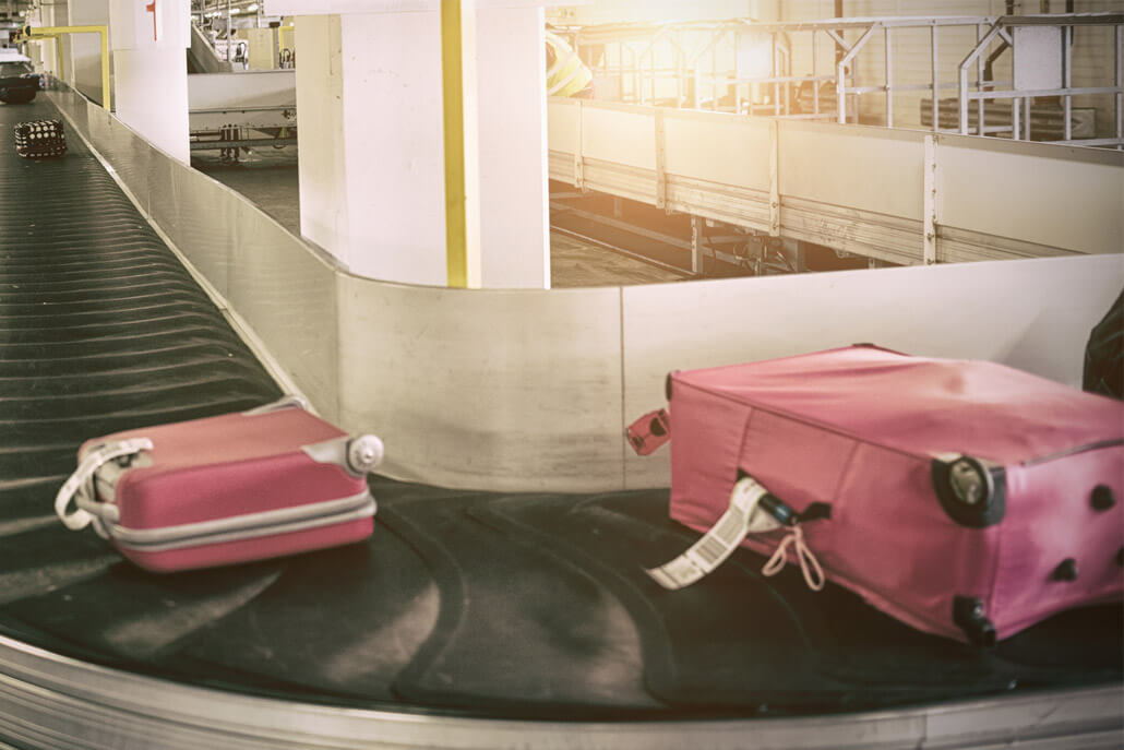 Colorful luggage on airport carousel