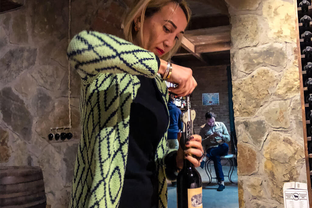 Opening a bottle of wine at Royal Wine bar in Tbilisi Georgia