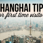 View of Shanghai with text overlay: Shanghai Tips for First Time Visitors