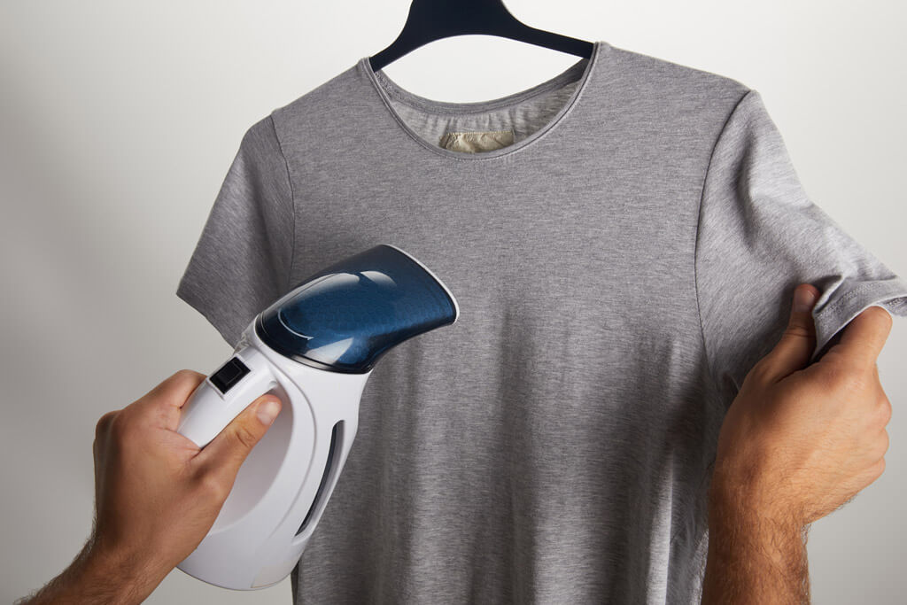 Using a travel steamer on a T-shirt