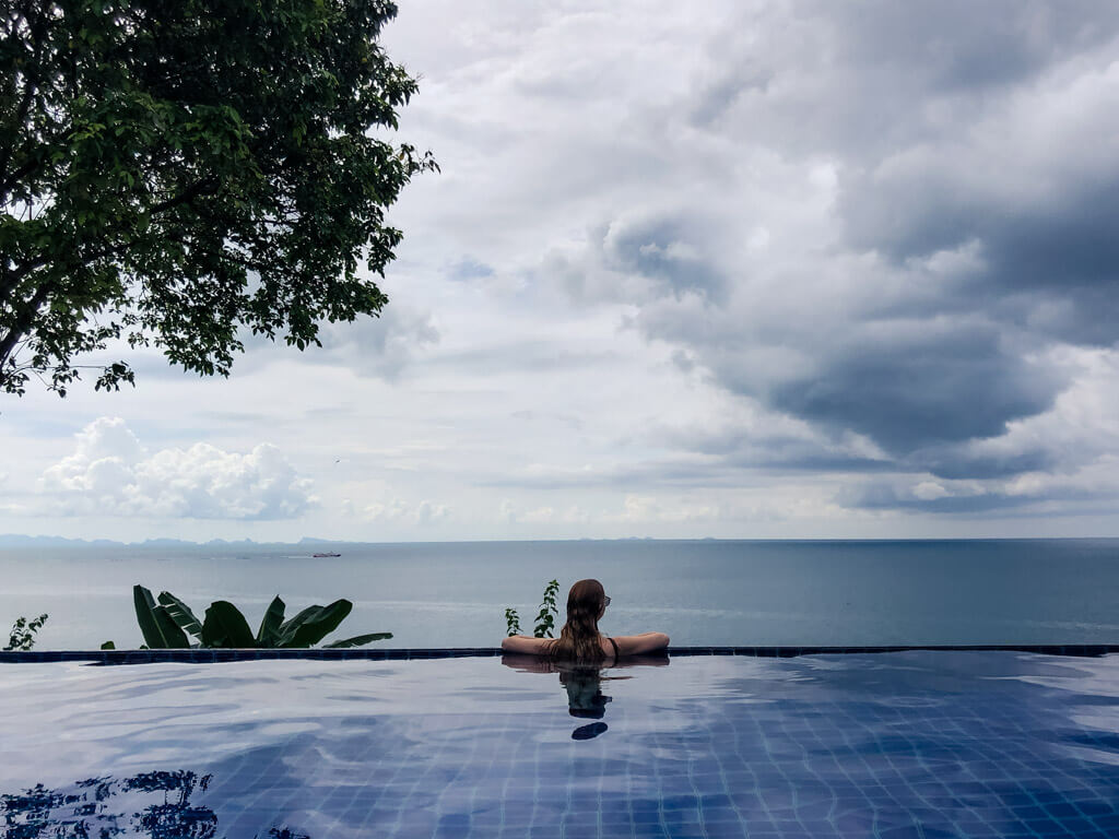 Looking out to the sea from an infinity pool