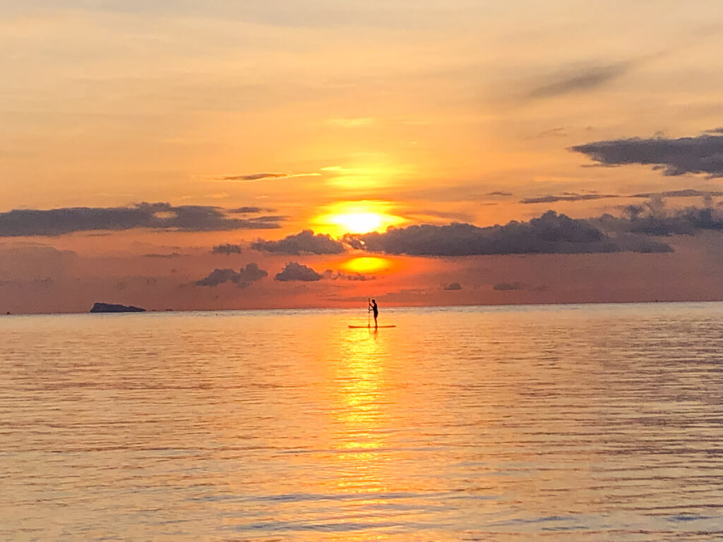 Stand up paddleboard upon sunset