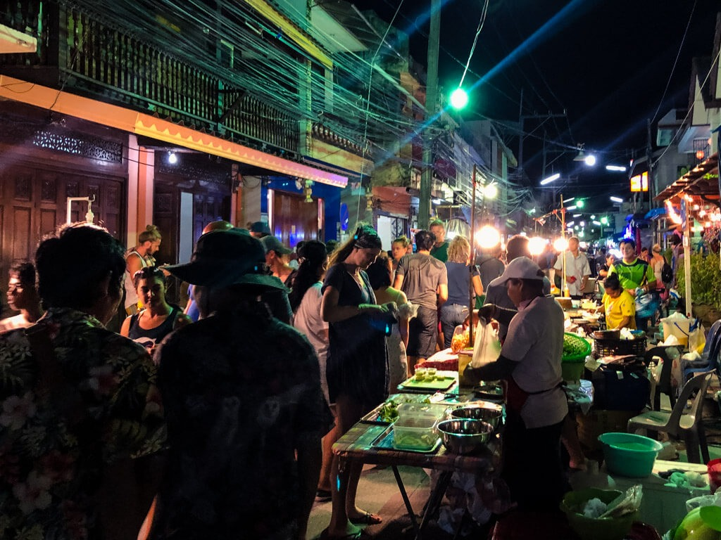 People at a market in Thailand