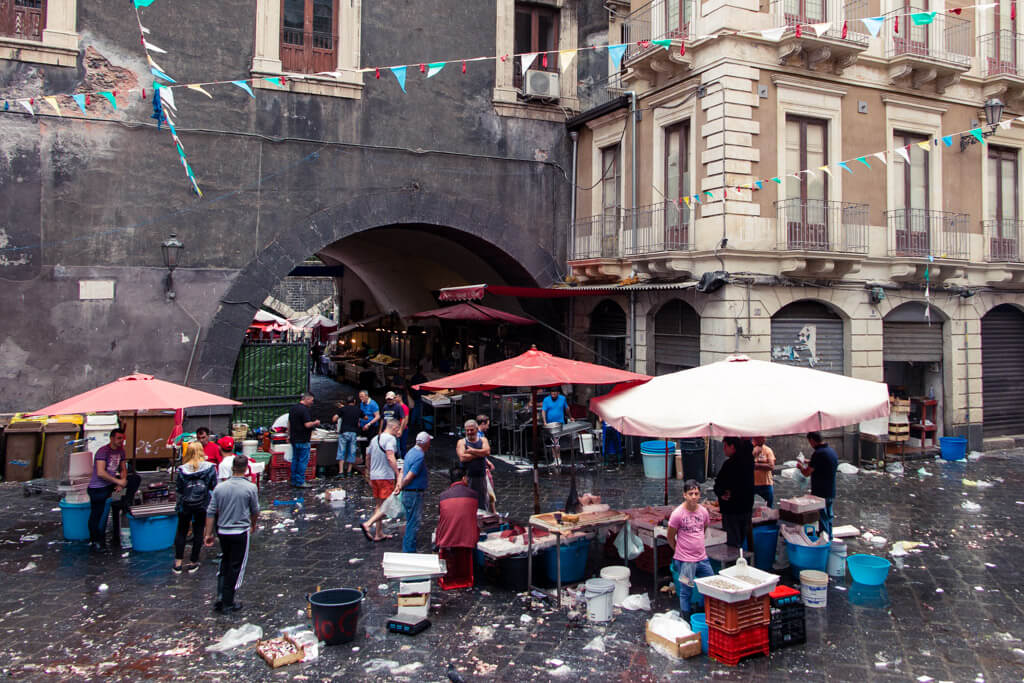 View of Catania Fish market with stalls and dirty tiles