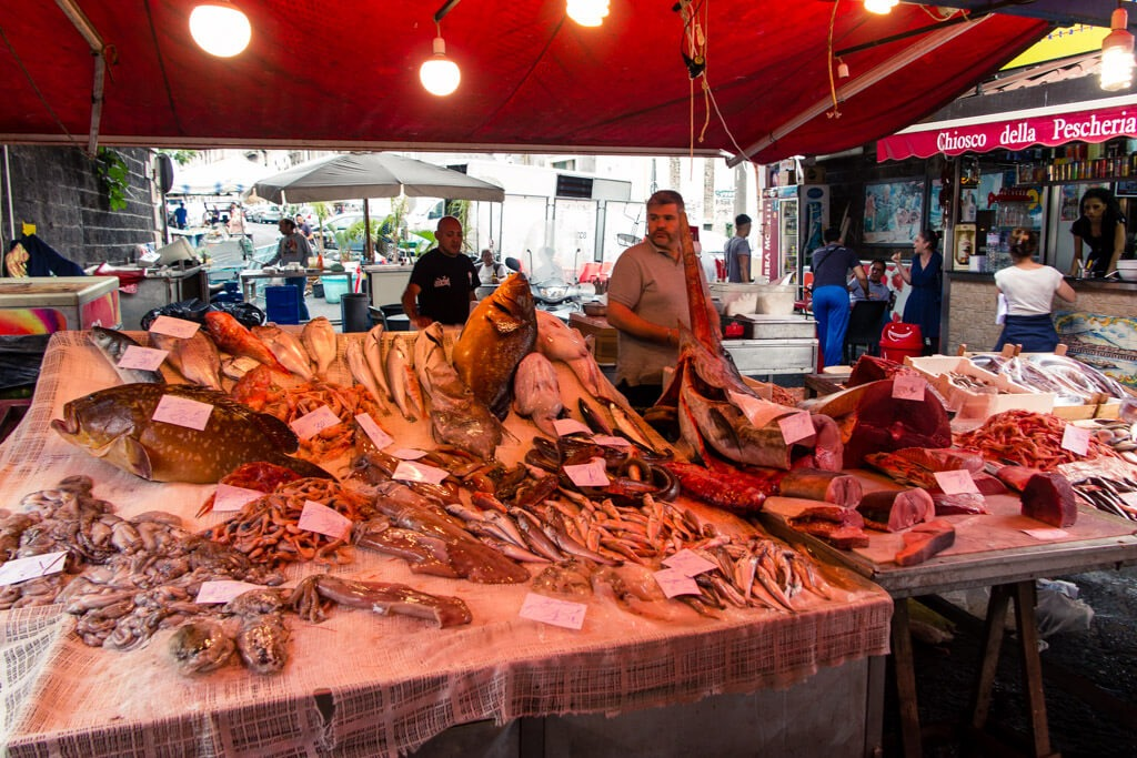 Fish market in Catania with fresh catch on display