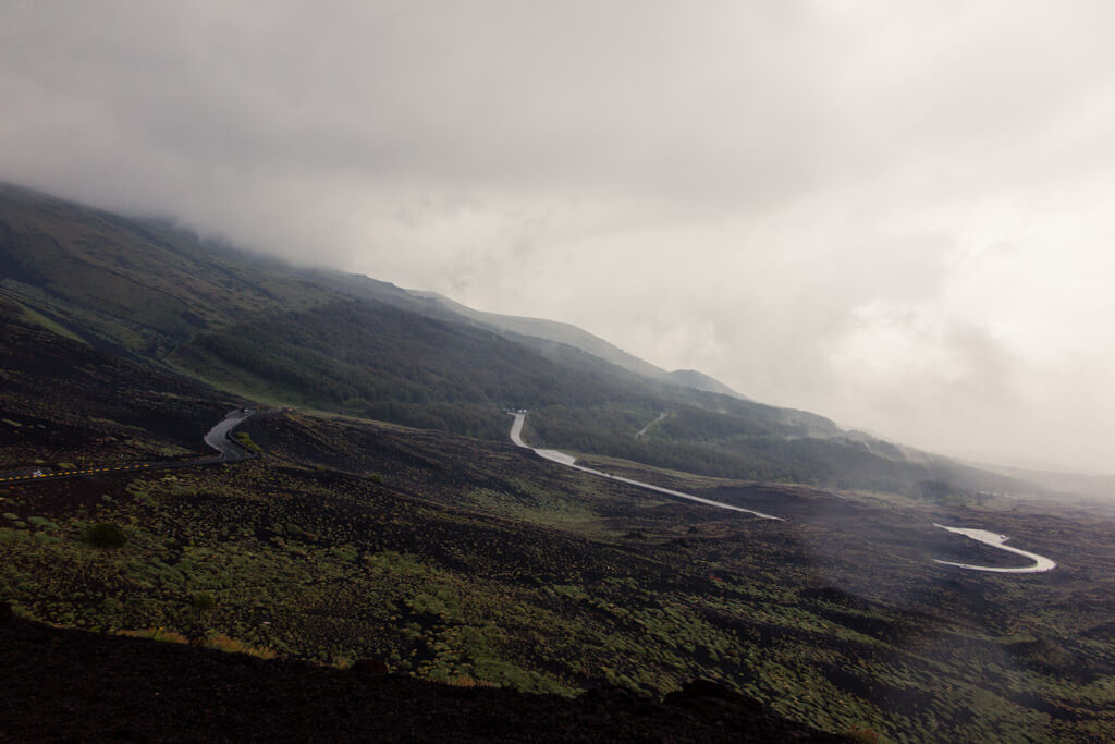 A road leading down Etna vulcano in Sicily