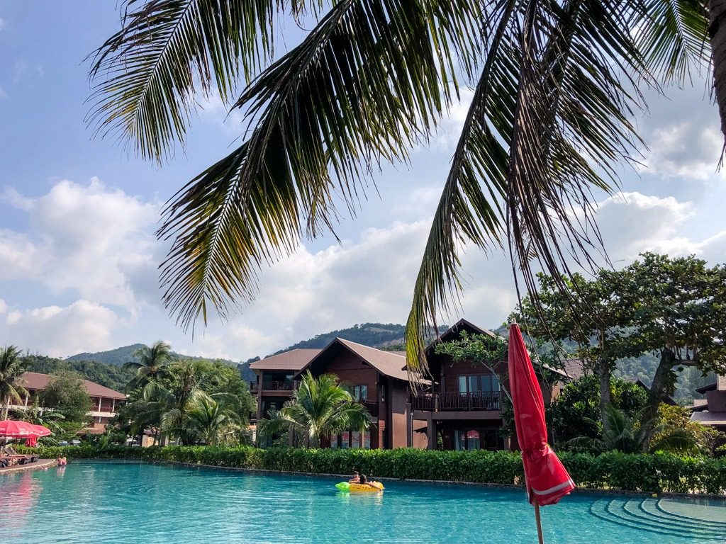 A resort swimming pool with poolside villas in Koh Phangan Thailand