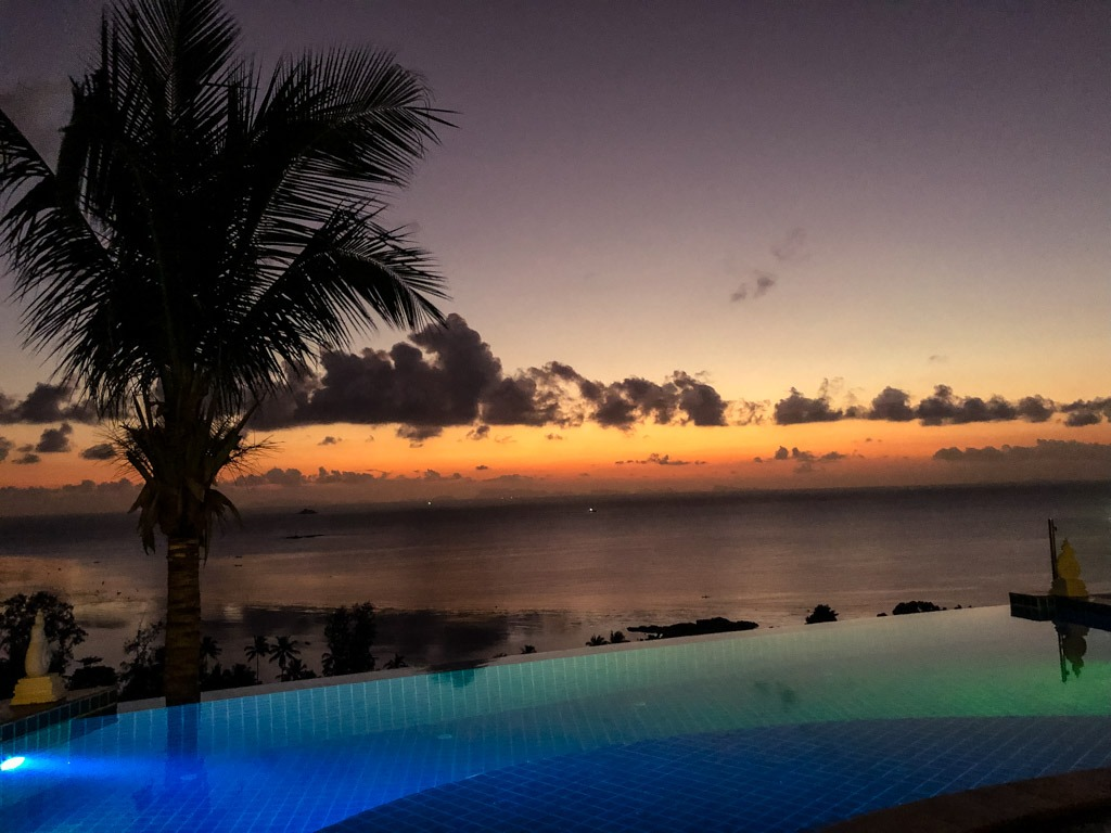 View of a sunset in Koh Phangan Thailand from an infinity pool
