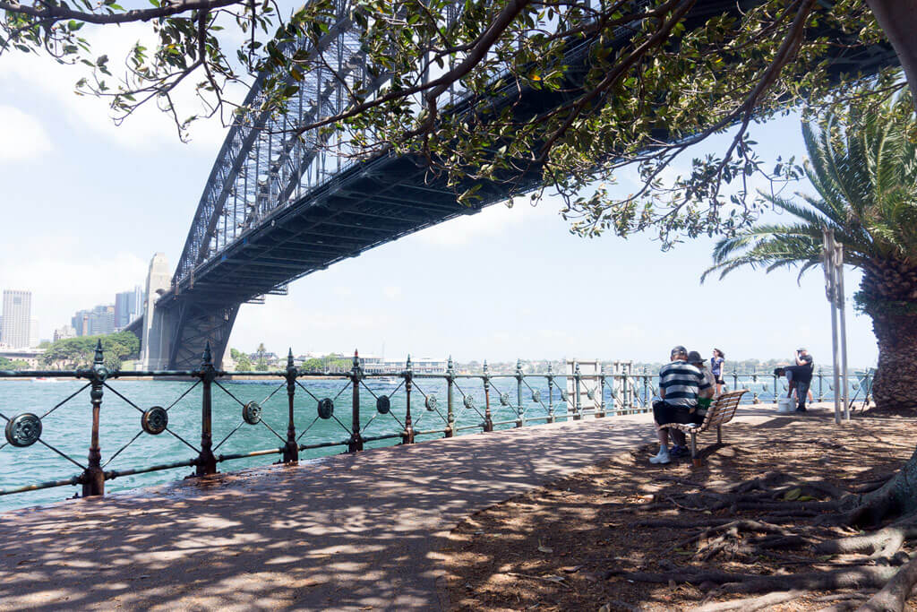 A seaside path under Sydney's Harbour Bridge