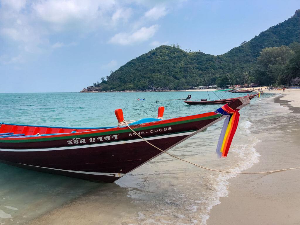 Thai longtail boats on a beach