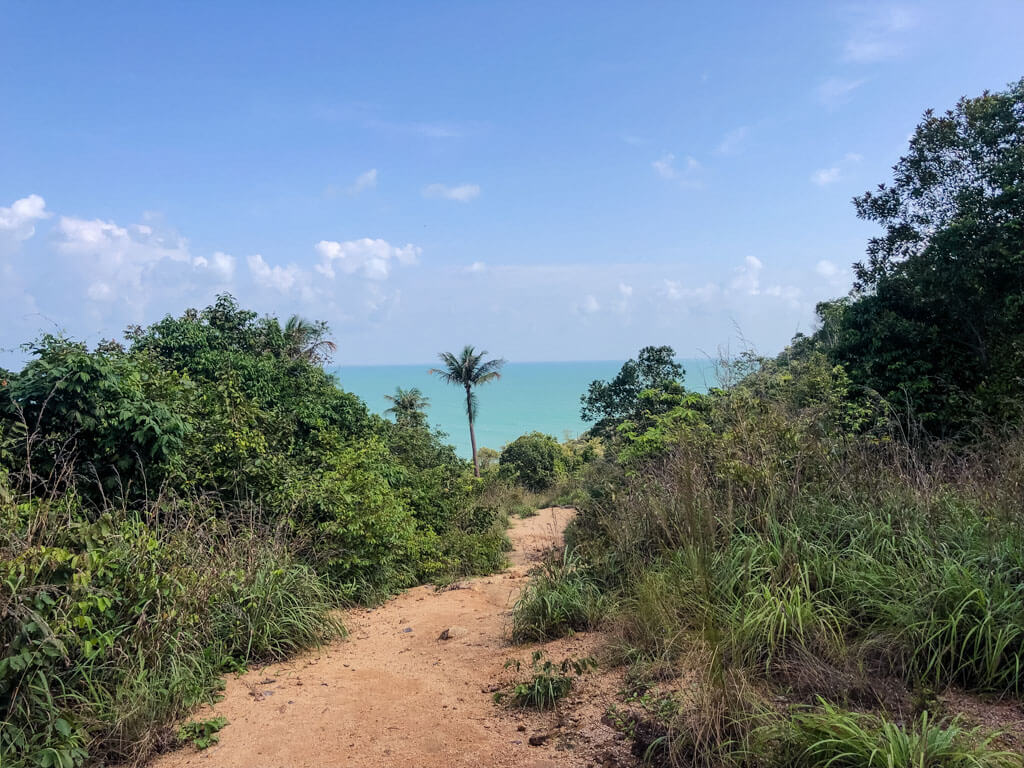 A dirt path with the sea in the distance, Koh Phangan
