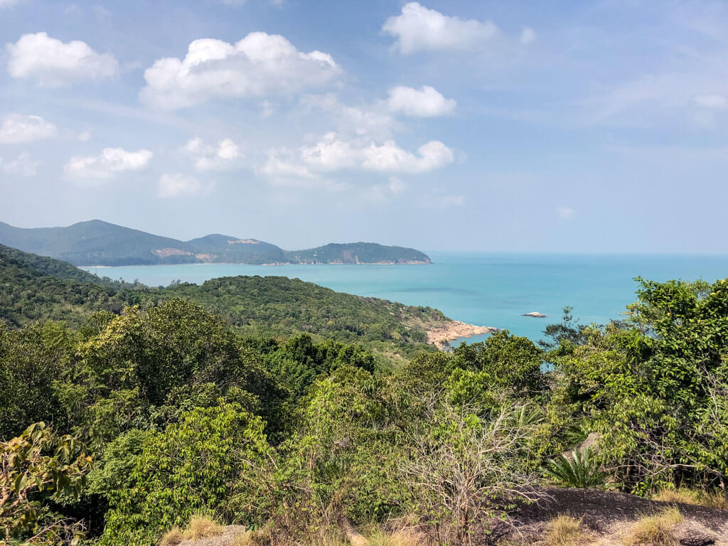 On a tropical island - views of green hills and the ocean