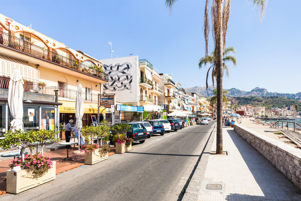 View of a beachside road in Giardini Naxos, Sicily