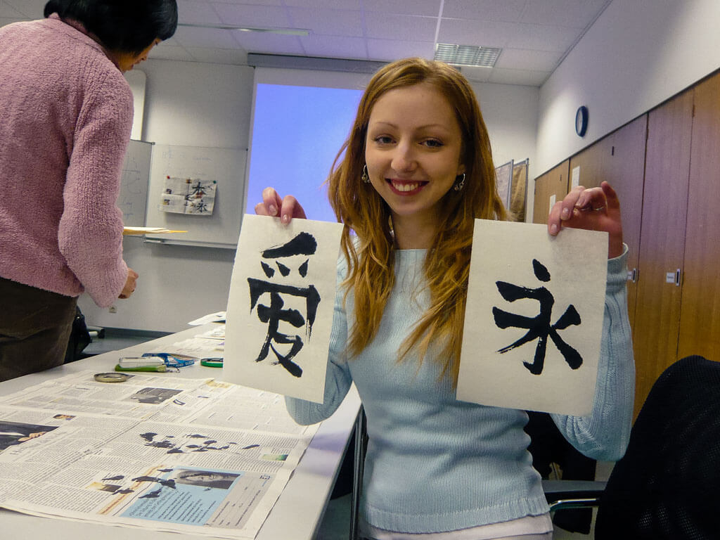 Drawing Chinese characters in a calligraphy class
