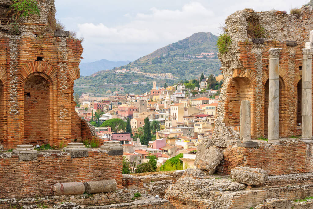 Taormina, Sicily - view of buildings through an amphitheatre