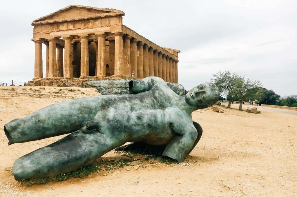 Valley of the Temples in Agrigento with a statue lying in front