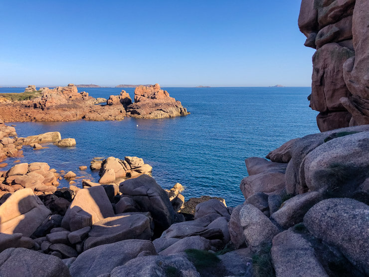 A cove framed with rocks on the Cote de Granit Rose in Brittany