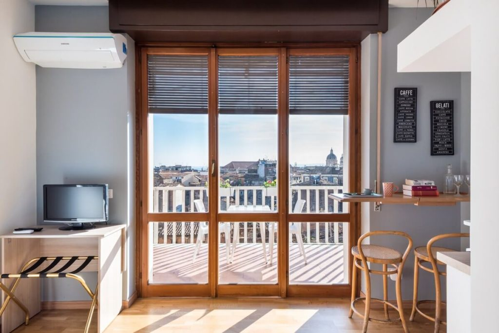 A studio apartment in Catania with a large terrace