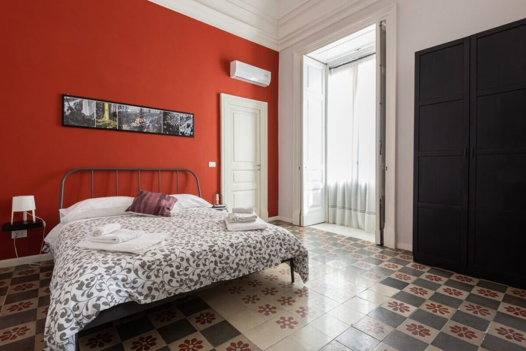 A room in a Catania apartment with original floors