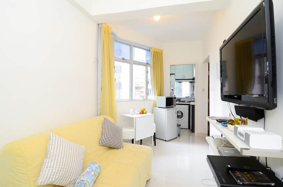 Small studio with yellow decor
